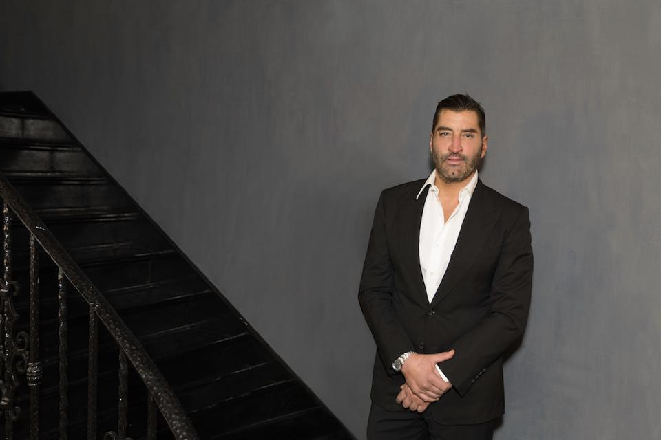 Man in a suit standing on a stairwell
