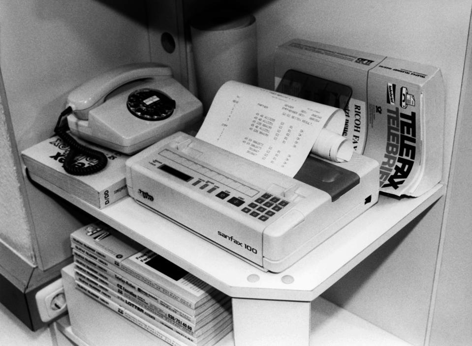 Black and white image of a fax machine in 1990.