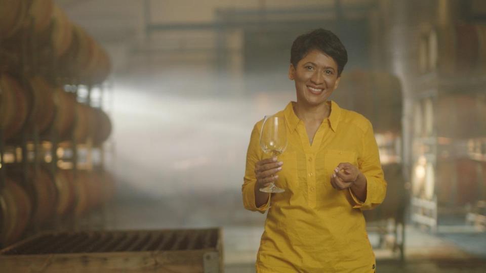 Carmen Stevens holds a glass of Sauvignon Blanc.
