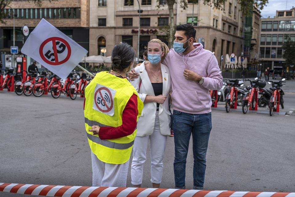 An anti 5G activist is seen informing walkers of the health...