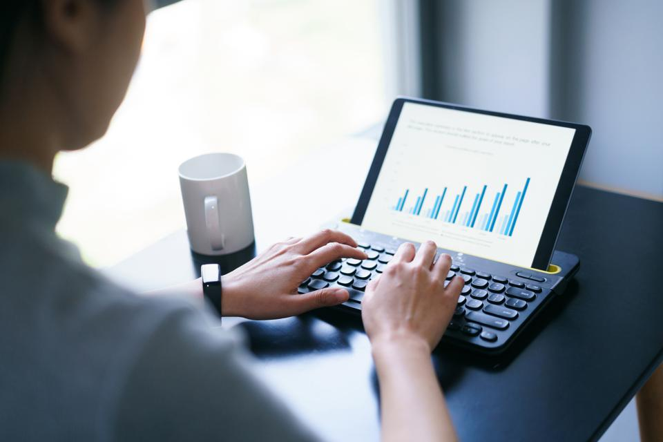 business woman working with business report on digital tablet