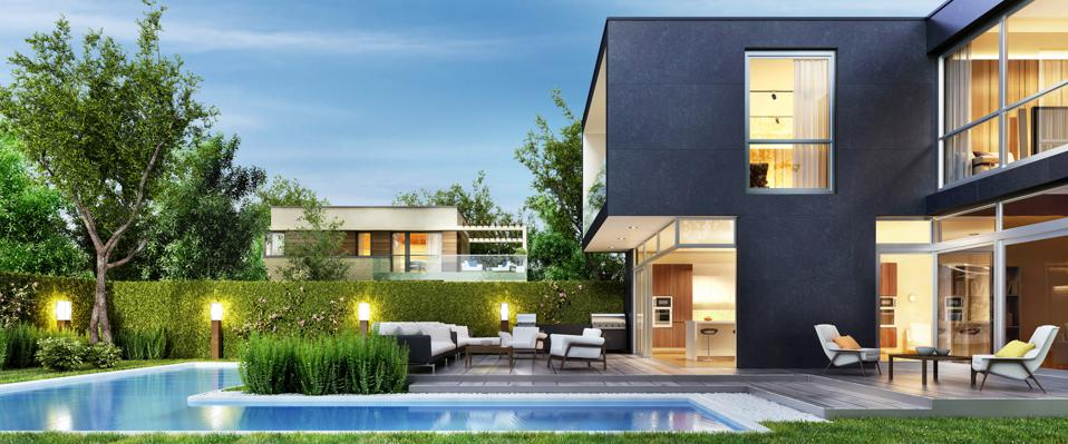 Modern black house with patio and pool