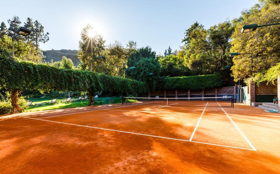 A clay tennis court.