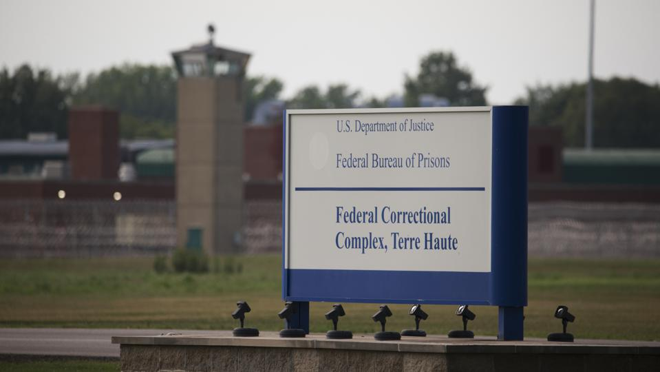 View of a sign outside the Terre Haute Federal Correctional...