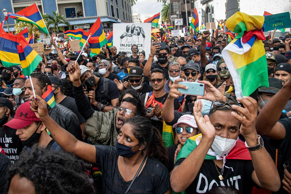 Mauritians have been marching on the streets in protest against how the oil spill has been handled. Such marches are rare in the tourist driven country.