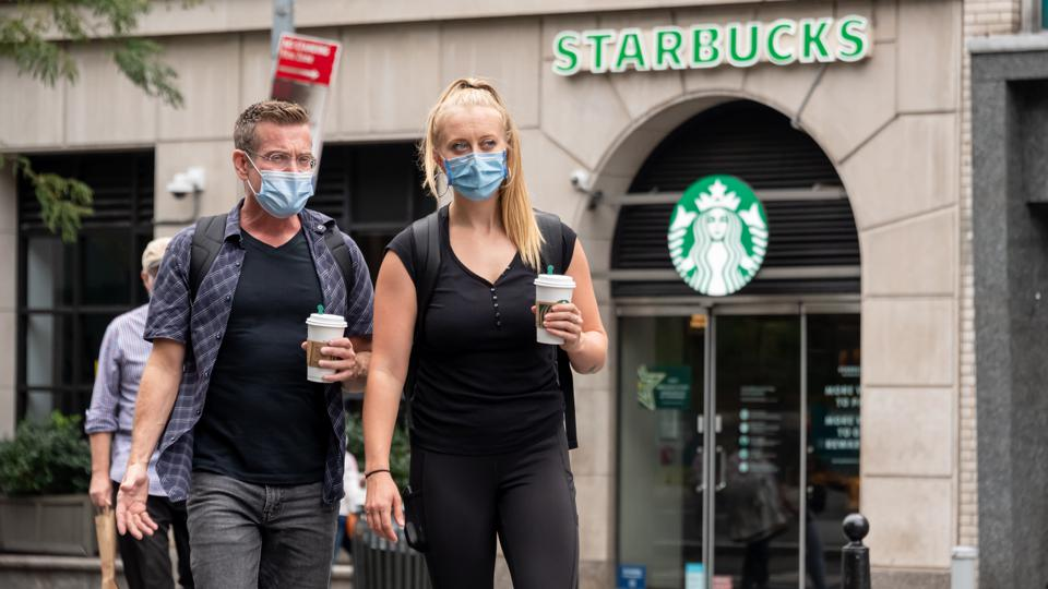 Starbucks customers in September 2020 in NYC's Union Square dealing with COVID-19 restrictions