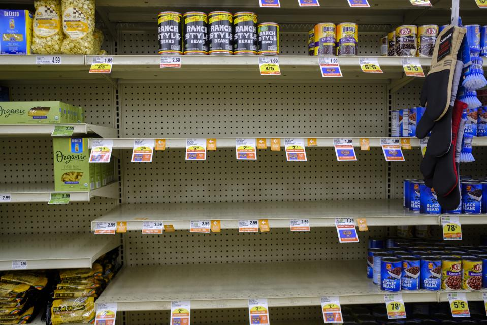 Canned bean shelves are empty at a Save Mart supermarket...