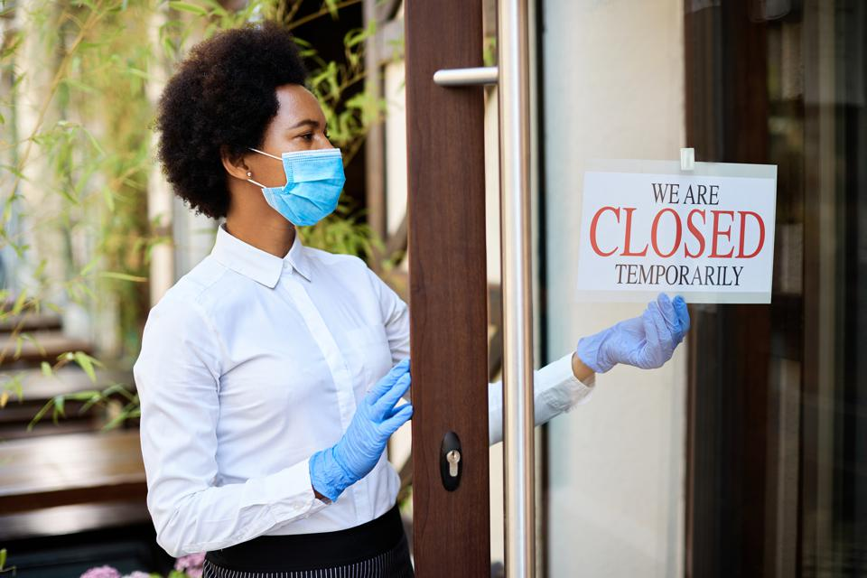 African American waitress closing a cafe due to coronavirus pandemic.