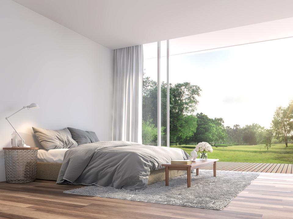 Modern bedroom with large open door to garden 3d render