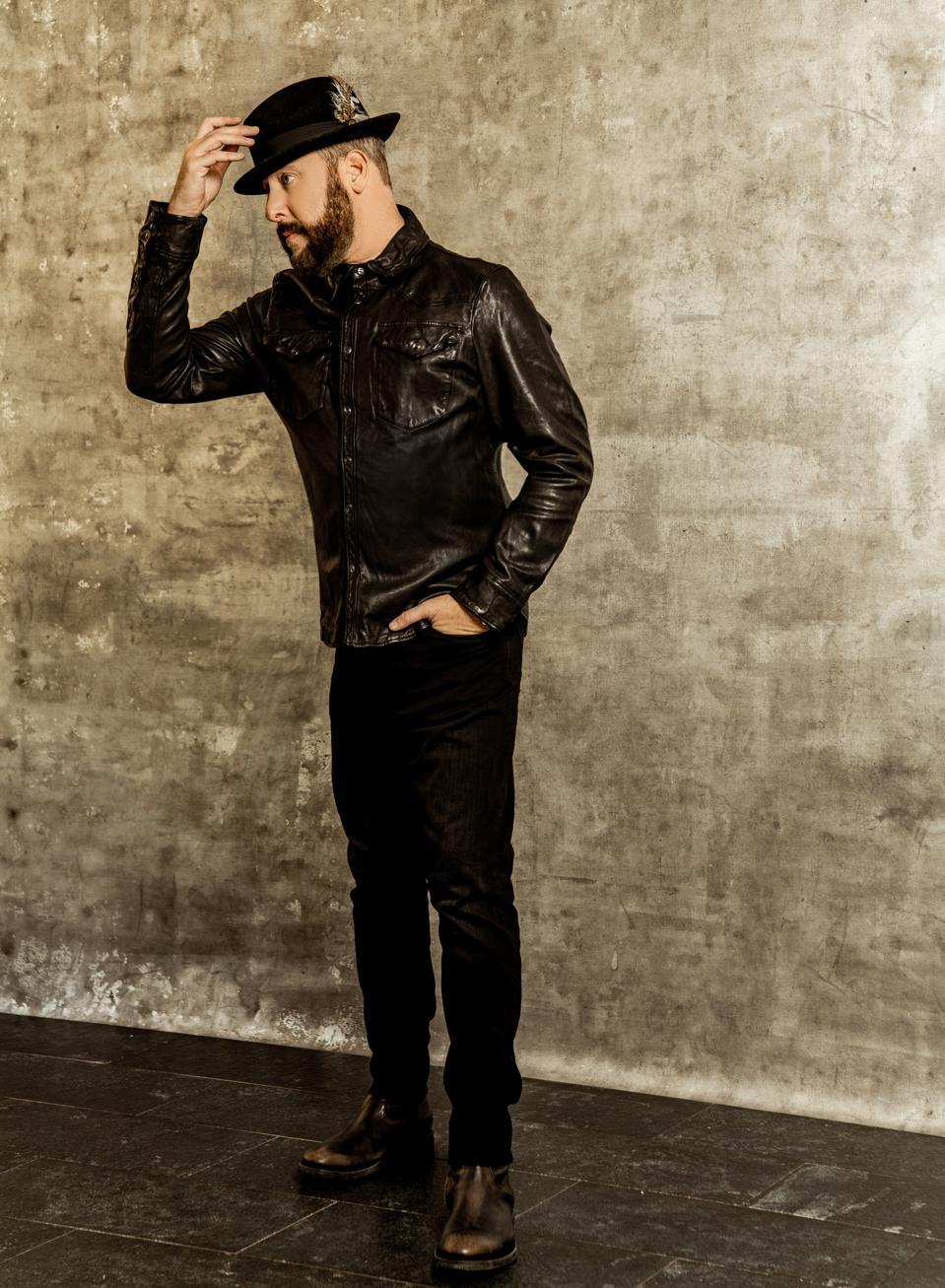Brad Feinstein - CEO, Romulus Entertainment wears Black leather western shirt  isRalph Lauren. Jeans RRL.  Boots Frye,  watch Rolex