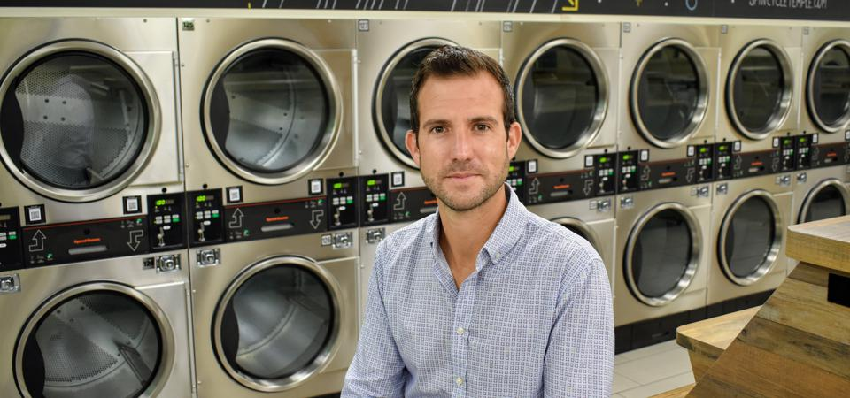 Brad Steinberg, CEO of PWS Inc., in one of his company's laundromats