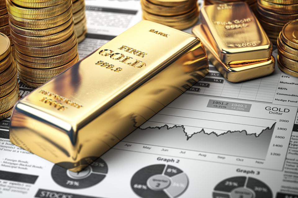 Gold bar, ingots and coins on financial  report. Growth of gold on stock market concept.