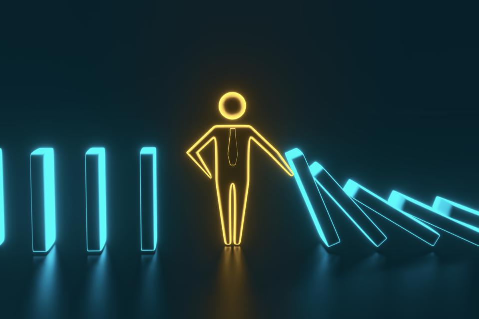 Man figure stopping the domino effect. 3D rendering