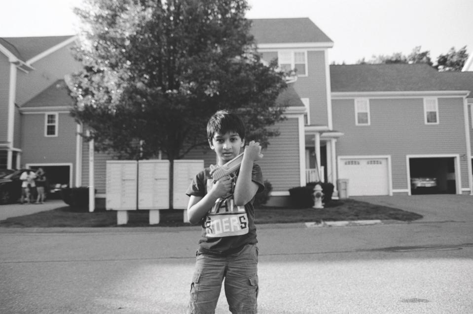 A boy holding a toy gun