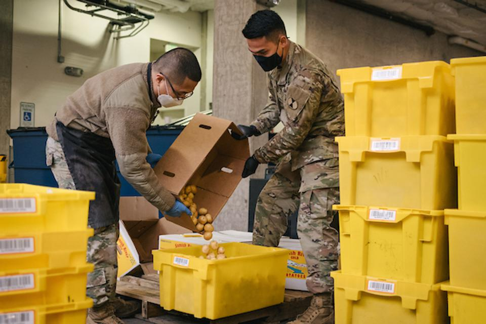 National Guard members help out at the University District Food Bank in Seattle.