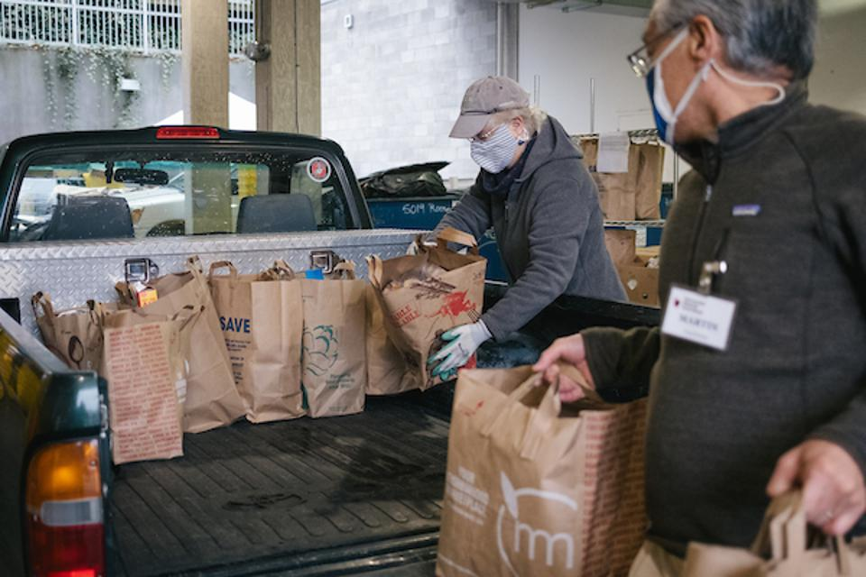 Home delivery requests have increased at the University District Food Bank in Seattle.
