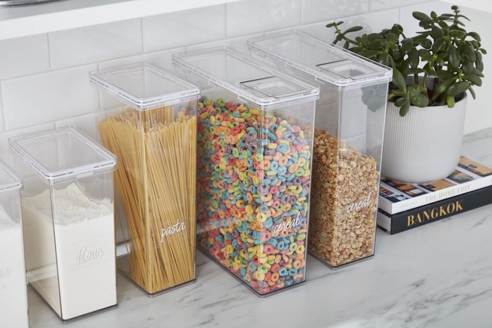 container store clear bins on a coutnertop