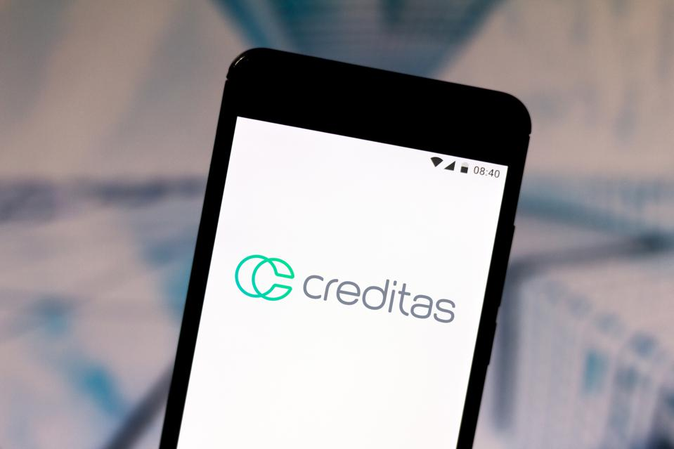 In this photo illustration a Creditas logo seen displayed on...