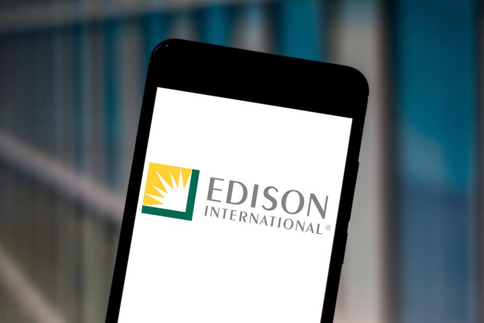 In this photo illustration a Edison International logo seen...