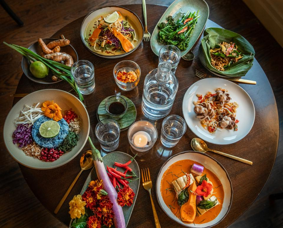 A table filled with colorful Thai dishes