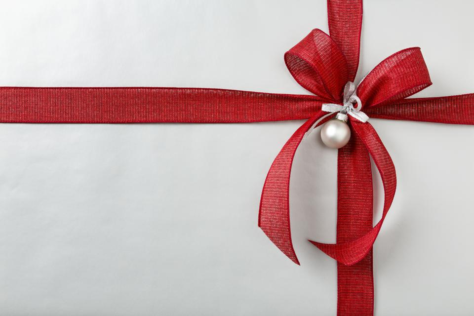 Perfect big red bow on classic Christmas gift present background