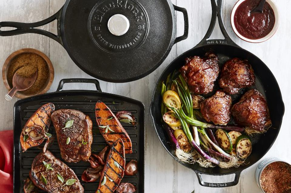 Overhead view of cast iron pans with steaks cooking