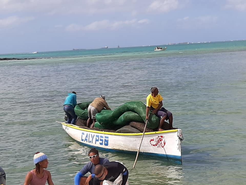 Each boat had several crew who could take the artisanal booms out.  Seen here, local fishing boat, The Calypso.