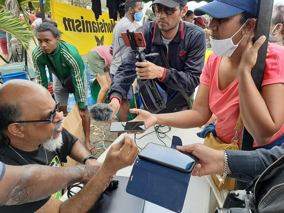 Ashok Subron, spokesperson for Mauritian Community Group, Rezistans ek Alternativ at Mahebourg waterfront as activists assemble oil protection booms