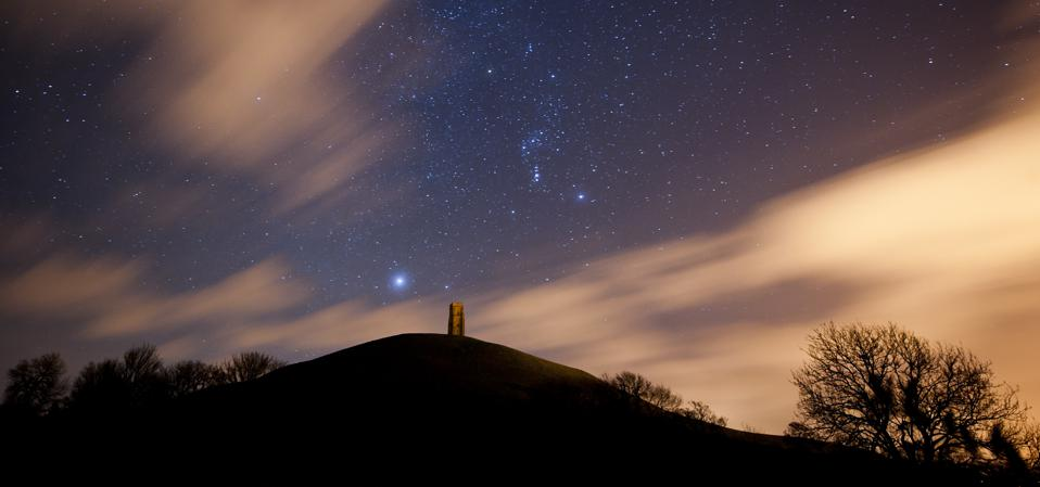 Sirius rises low above St. Michael's Tower on Glastonbury Tor with the constellation of Orion (center). Photo by Ben Birchall/PA Images via Getty Images