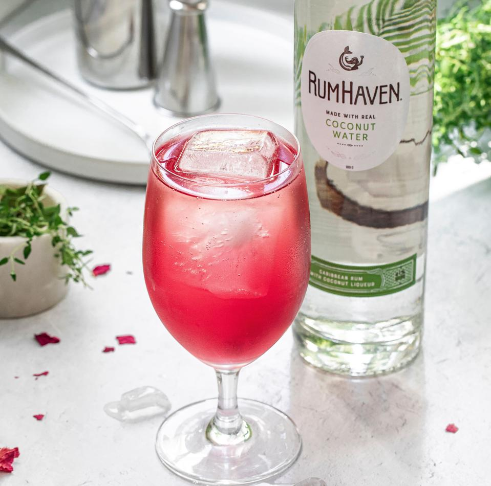 Bottle of RumHaven and cranberry cocktail