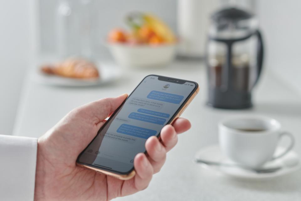 Man Using Smartphone In Kitchen