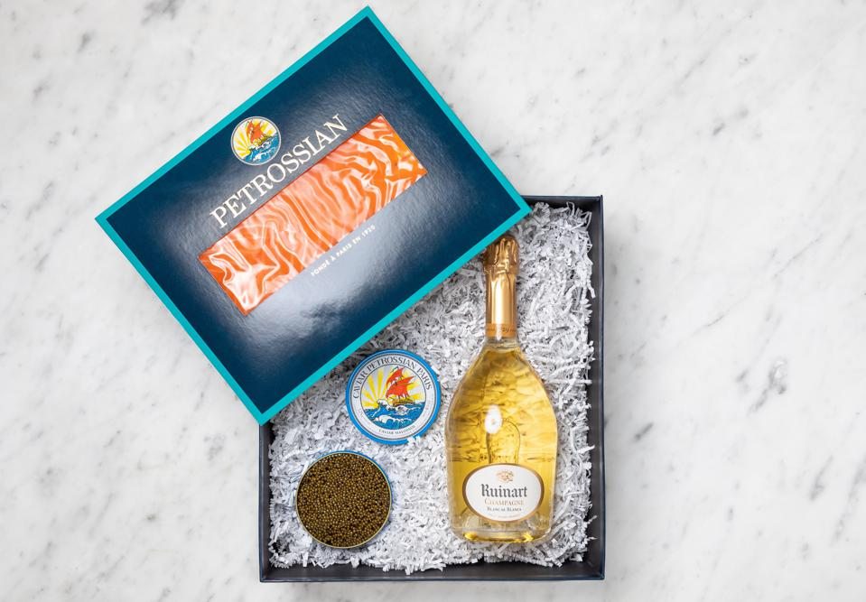 ruinant champagne paired with caviar in the gift box