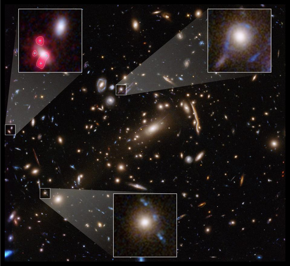 The massive galaxy cluster, MACS J1206, is revealed by Hubble in this image.