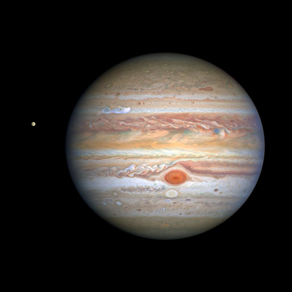 Jupiter's great red spot shines brilliantly in its 2020 Hubble image, with Europa nearby.