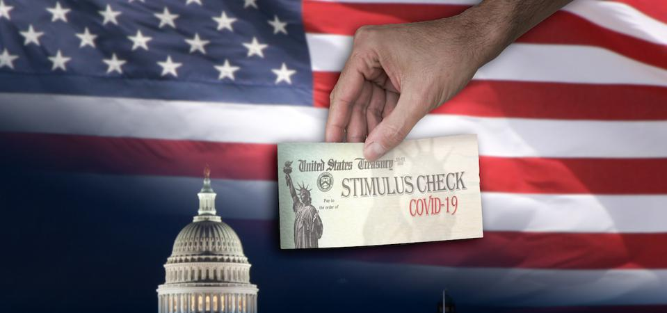 hand offering stimulus check with Congress and US flag in the background