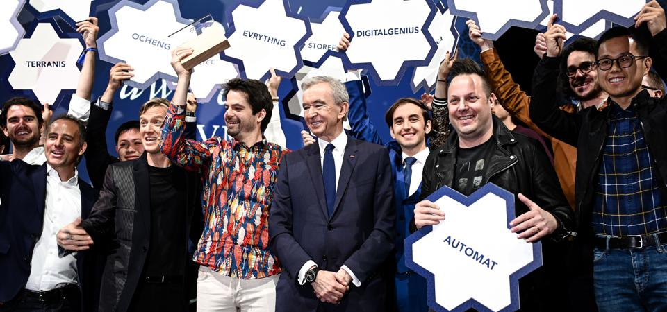 Entrepreneurs and CEOs celebrate at an event focused on innovation.