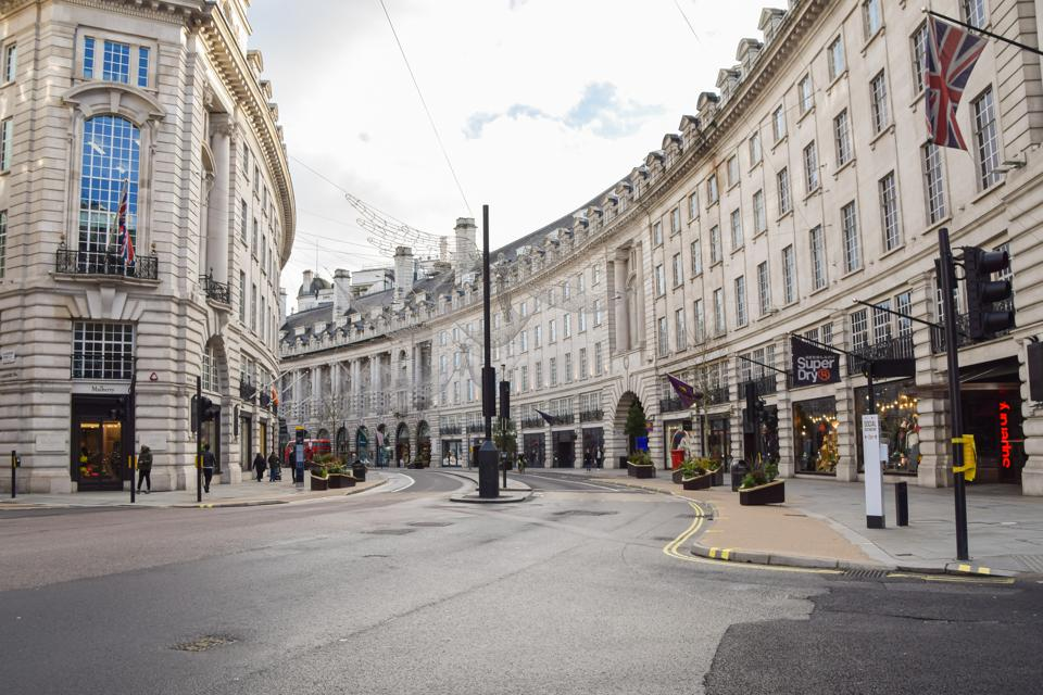 A view of a deserted Regent Street, as shops and businesses...