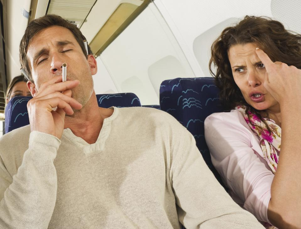 airline passenger smoking on plane