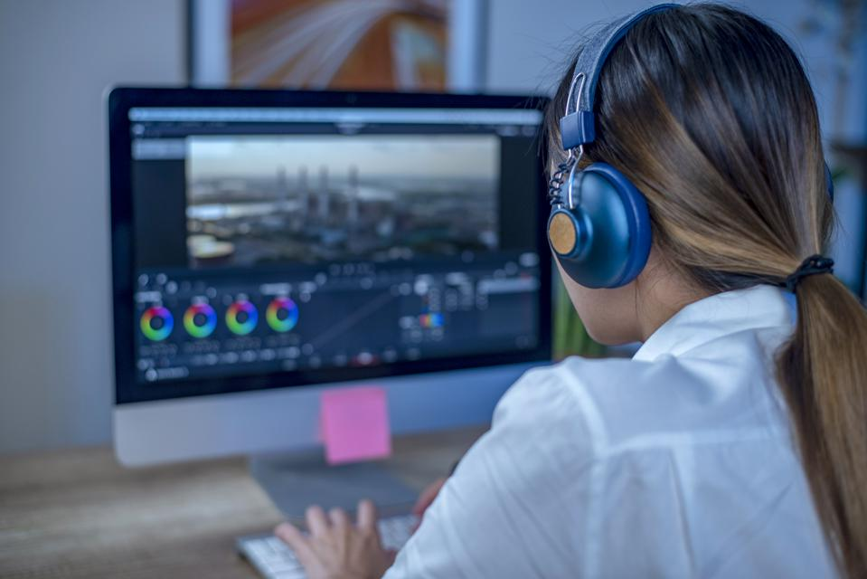 Woman video editing in her office.