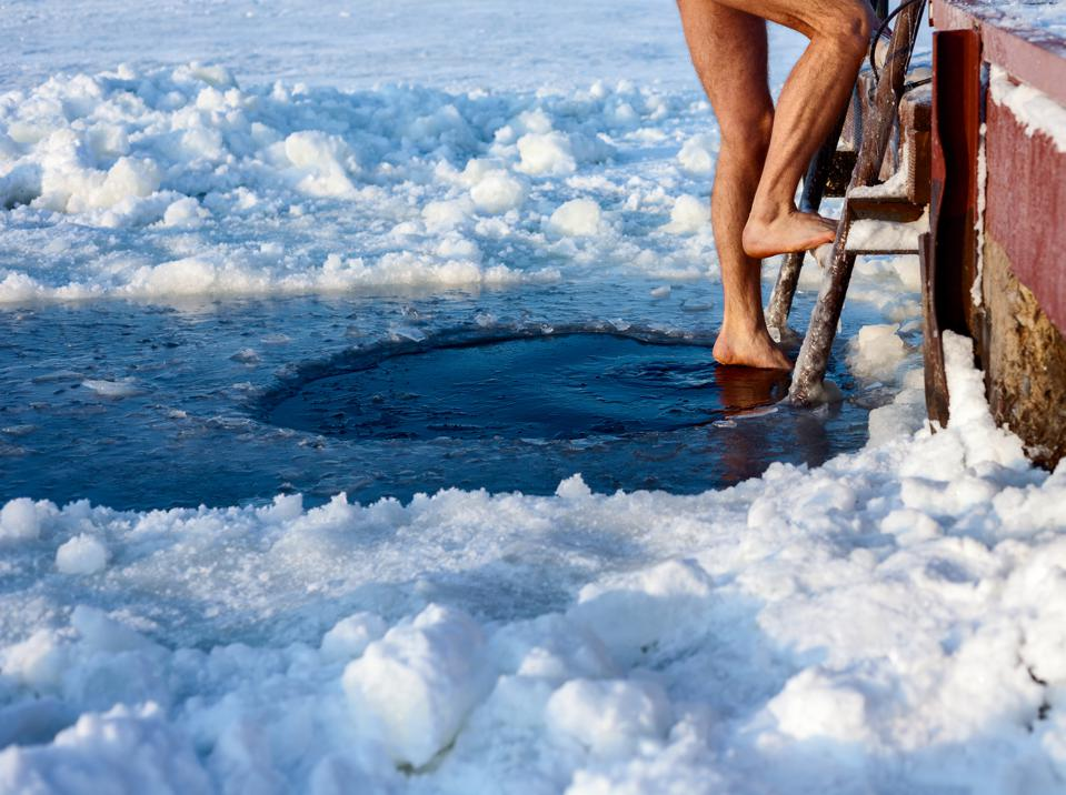 Ice hole swimming may be a 2021 wellness trend