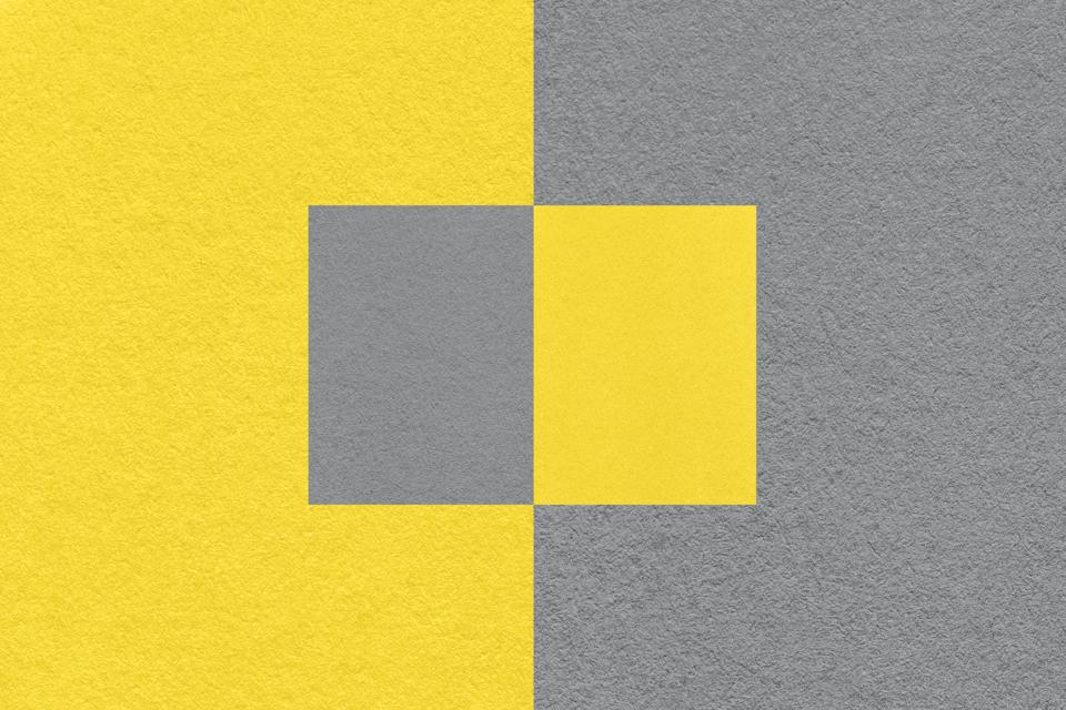 Pantone color of the Year 2021 Illuminating yellow and Ultimate Gray background.