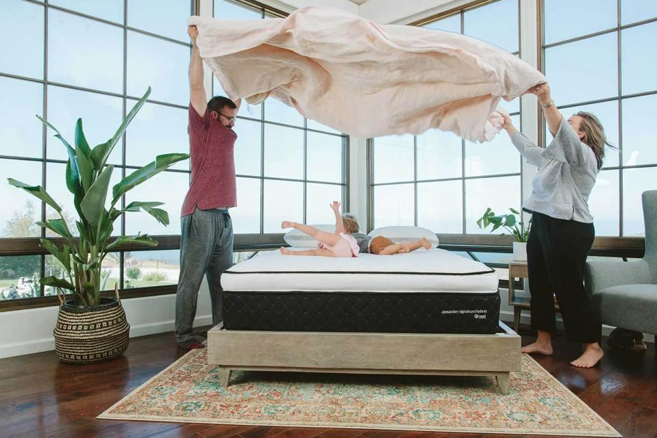 A family with the Nest Bedding The Alexander Signature Hybrid Mattress.