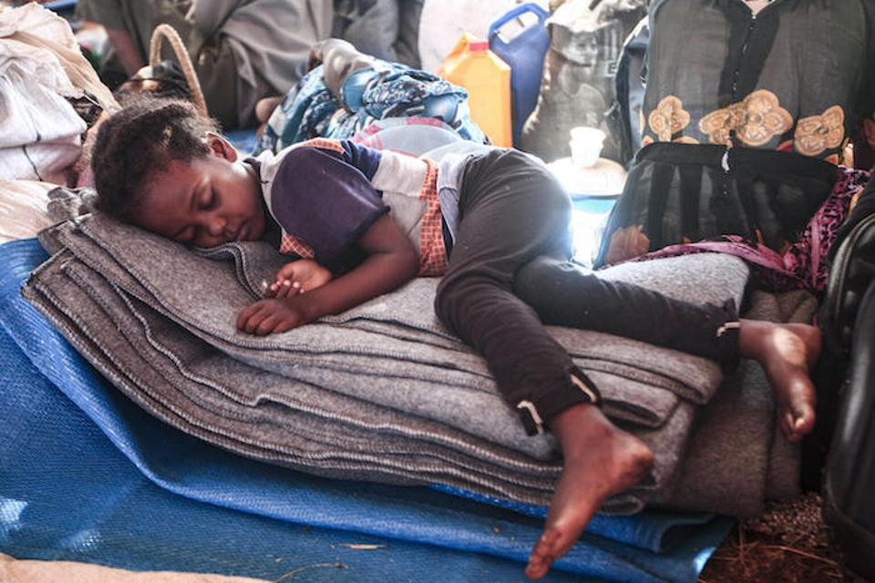 An Ethiopian refugee child who fled fighting in Tigray province sleeps in a hut at the Um Raquba camp in Sudan's eastern Gedaref province.
