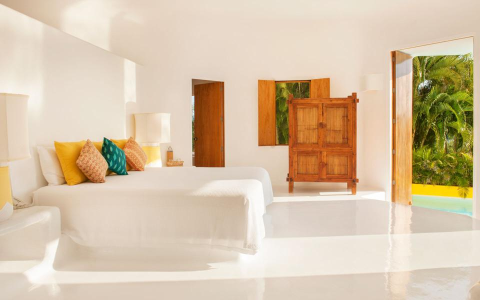 A white-walled bedroom.
