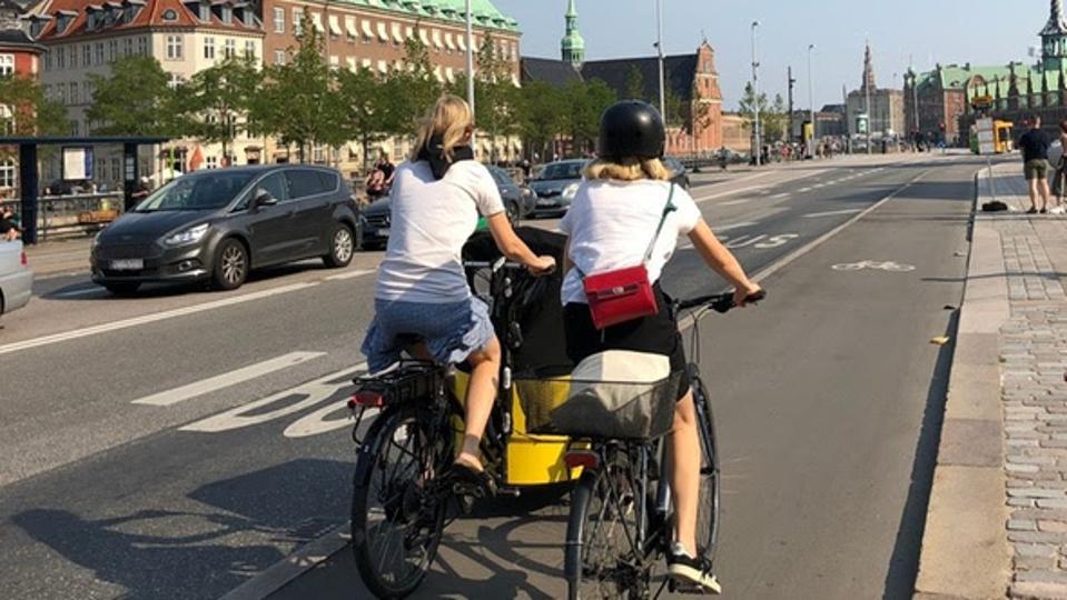Two women riding bikes in Copenhagen.