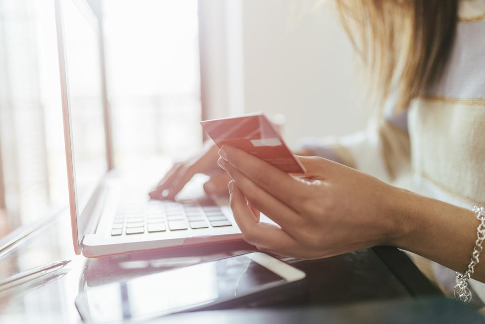 Close-up of woman buying from home on the laptop