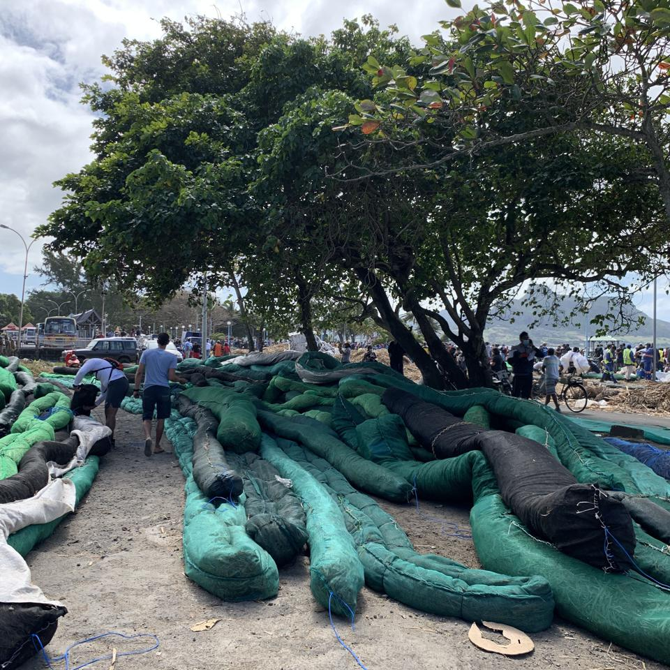 Artisanal booms being lined up ready for deployment along the South East Coast of Mauritius