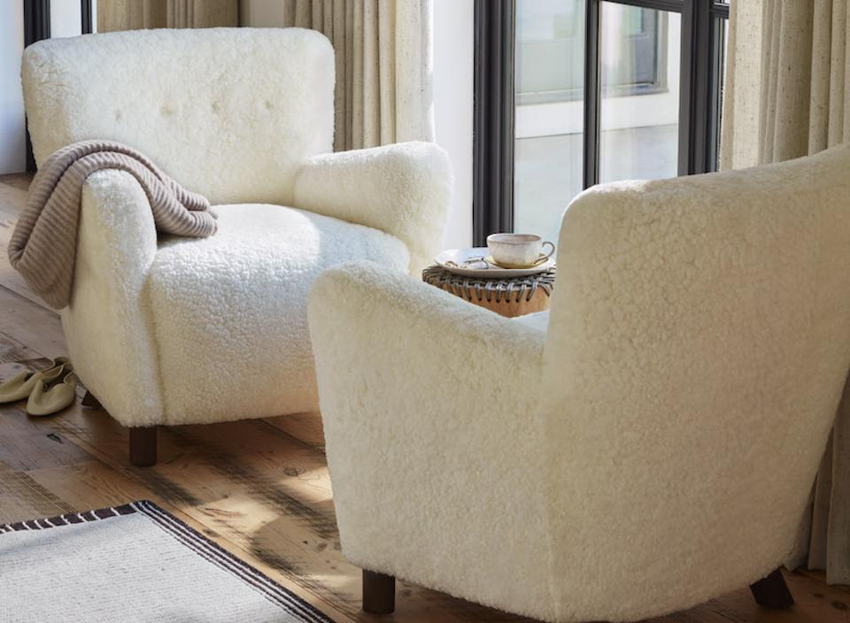 White boucle chairs facing each other in a living room