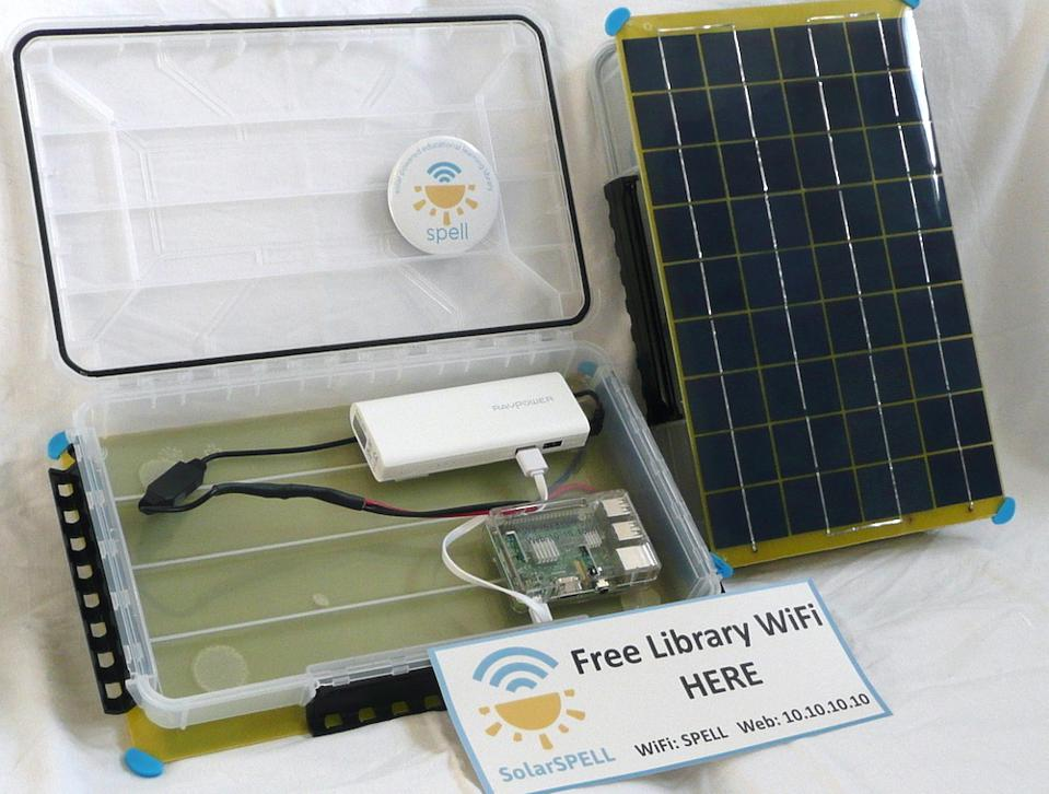 A plastic box with computer components, and paper reading ″Free Library WiFi HERE″