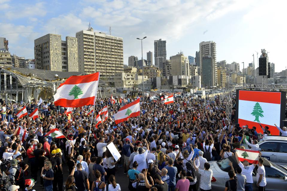 Aug 11: Lebanese demonstrators gather to march towards the parliament building following the resignation of Lebanese government on the fourth day following a major explosion at the Port of Beirut.